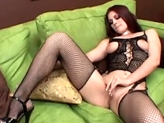 Slut teases in fishnet lingerie and sucks dicks