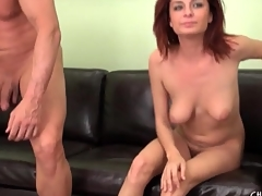 Cute nude redhead gives him a blowjob on camera