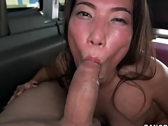 Asian impenetrable sucks off his cock in burnish apply car