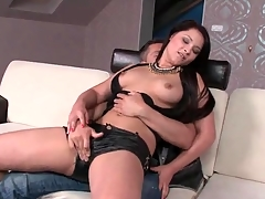 Chick close to sexy leather shorts gives a lap dance